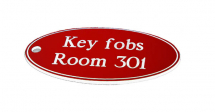 50X100MM KEY FOB OVAL - WHITE TEXT ON RED
