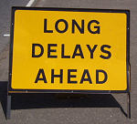 LONG DELAYS AHEAD